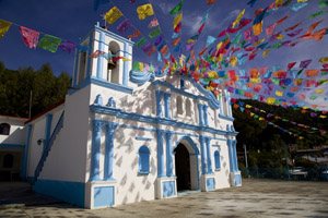 Festive holiday flags on Mexican church