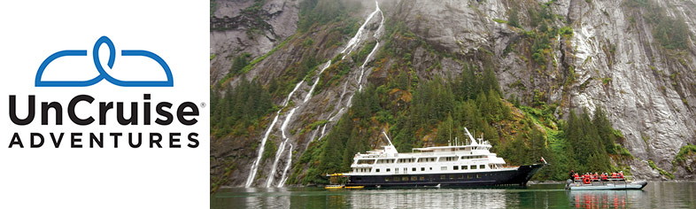 Uncruise near water fall in Alaska Fjord