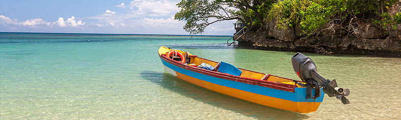 Boat anchored on Jamaica beach